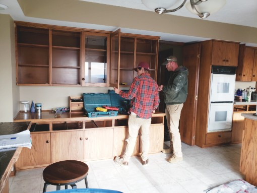 Crew Setting Cabinets